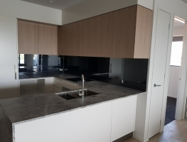 Grey Tint Toughened Mirror Splashback by Graphic Glass Services Qld