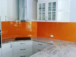Stunning Sunrise Orange Colourback Glass Kitchen Splashback by Graphic Glass Services Qld