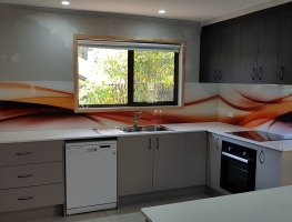 Orange Splash Digital Printed Glass Splashback by Graphic Glass Services