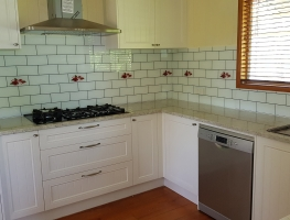 Digital-Printed-Subway-Tile-Glass-Splashback-with-Red-Flowering-Wattle-by-Graphic-Glass-Services-