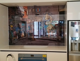 """Digitally Printed Glass Splashback by Graphic Glass Services Qld """"Life In The Alley"""" image by Visual Resources"""