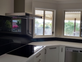 Taubmans Black Jack coloured toughened glass splashback by Graphic Glass Services
