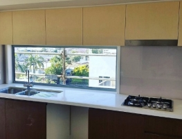 Colourback Glass Splashback in Bone White by Graphic Glass Services Qld