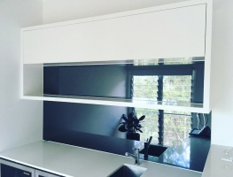 Grey Toughened Mirror Glass Kitchen Splashback by Graphic Glass Services Qld