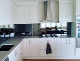 Grey Toughened Mirror Splashback by Graphic Glass Services Qld