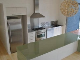 Colour Backed Glass Benchtop by Graphic Glass Services Qld