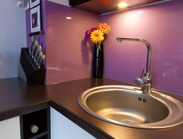 Colour Backed Glass Kitchen Splashback in purple by Graphic Glass Services Qld