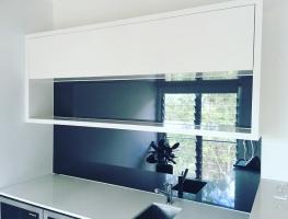 Grey Toughened Mirror Glass Kitchen Splashback by Graphic Glass Services Qld