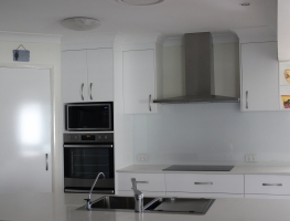 Colourback Glass Splashback in White 101 by Graphic Glass Services Qld