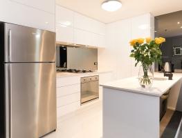 Grey Toughened Mirror Kitchen Splashback by Graphic Glass Services Qld
