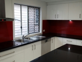 Red Oceanic Glass Splashback by Graphic Glass Services Qld