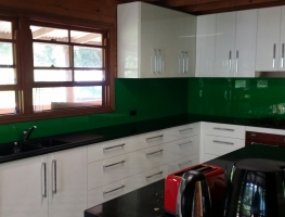 Green Colourback Glass Splashback by Graphic Glass Services Qld